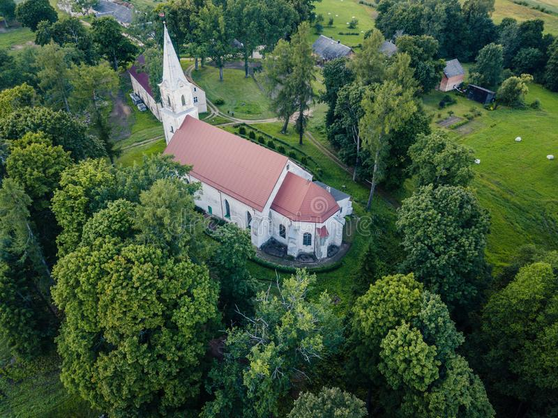 Aerial Photo of an Old Lutheran Church in Countryside Between Trees in Early Spring on Sunny Day, Close up stock image