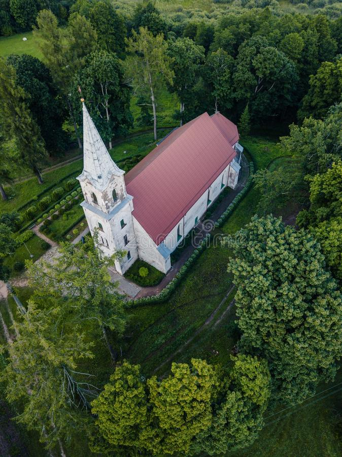Aerial Photo of an Old Lutheran Church in Countryside Between Trees in Early Spring on Sunny Day, Close up royalty free stock photo