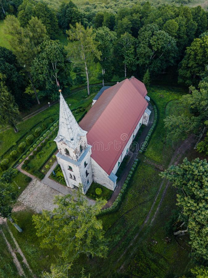 Aerial Photo of an Old Lutheran Church in Countryside Between Trees in Early Spring on Sunny Day, Close up royalty free stock photography