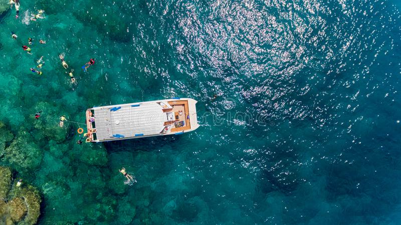 Aerial photo of people snorkeling in tropical Coral reef royalty free stock photography