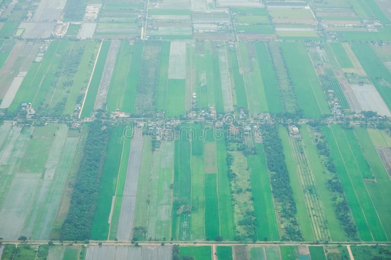 Aerial photo from a plane, top view, field roads and green field. And farm in Thailand stock images