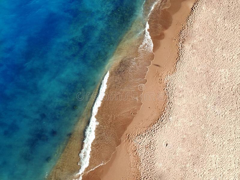Aerial Photo Of A Pristine Exotic Sandy Beach Near a Blue Seaside stock photo