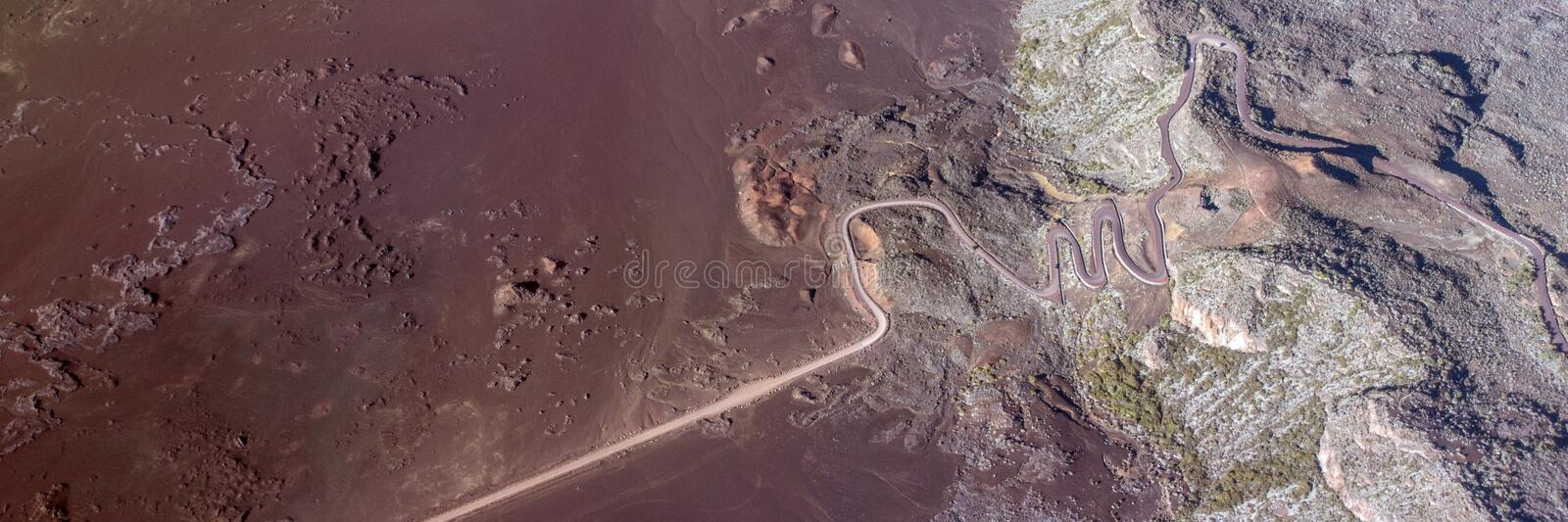 Aerial photo of Road in volcanic landscape of Plaine des Sables, Reunion Island stock photos