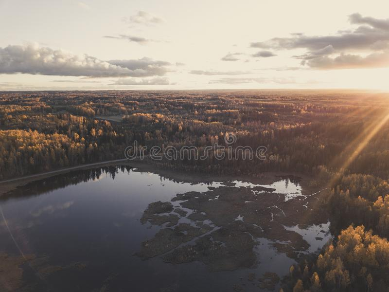 Aerial Photo of a Sunset over Forest in Autumn Day - vintage loo royalty free stock images