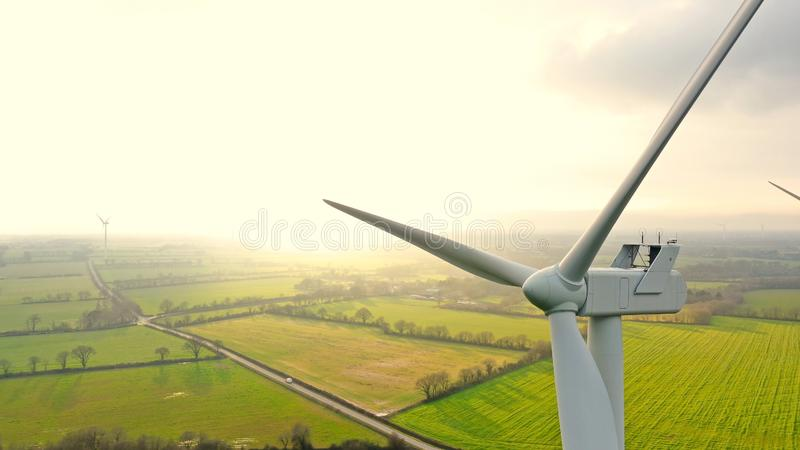 Aerial photo of wind turbines at sunset in the french countryside. Aerial photo of wind turbines at sunset in Sainte Pazanne, France stock image