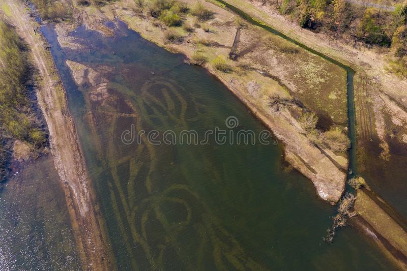 Aerial photograph of the inlet of a dam with the shallow water zone. Drone royalty free stock image