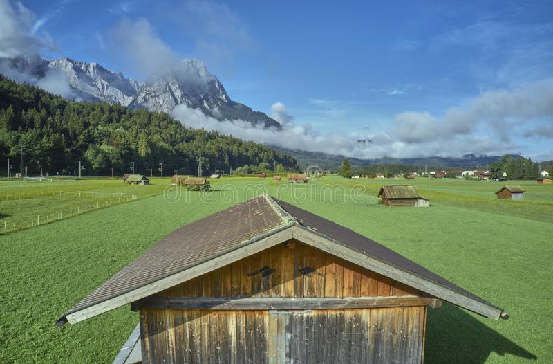Aerial photograph from low altitude of a woodshed on a pasture in the Alps.  stock photos