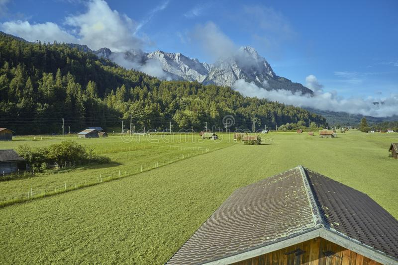 Aerial photograph from a low height over the roof of a woodshed on a pasture in the Alps.  royalty free stock photography