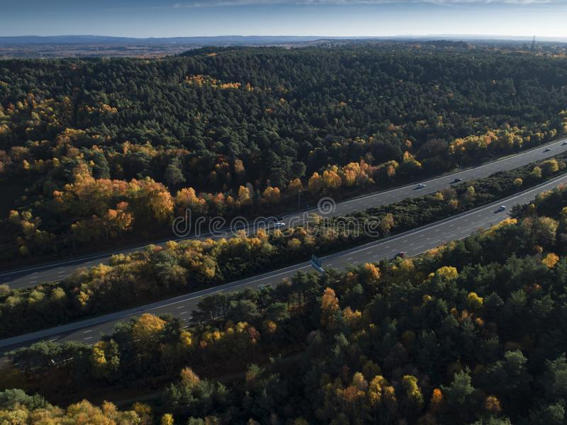 Aerial Photograph of M3 motorway cutting through Chobham Common. Aerial Photograph of the M3 motorway cutting through Chobham Common at sunset. This is an area royalty free stock photos