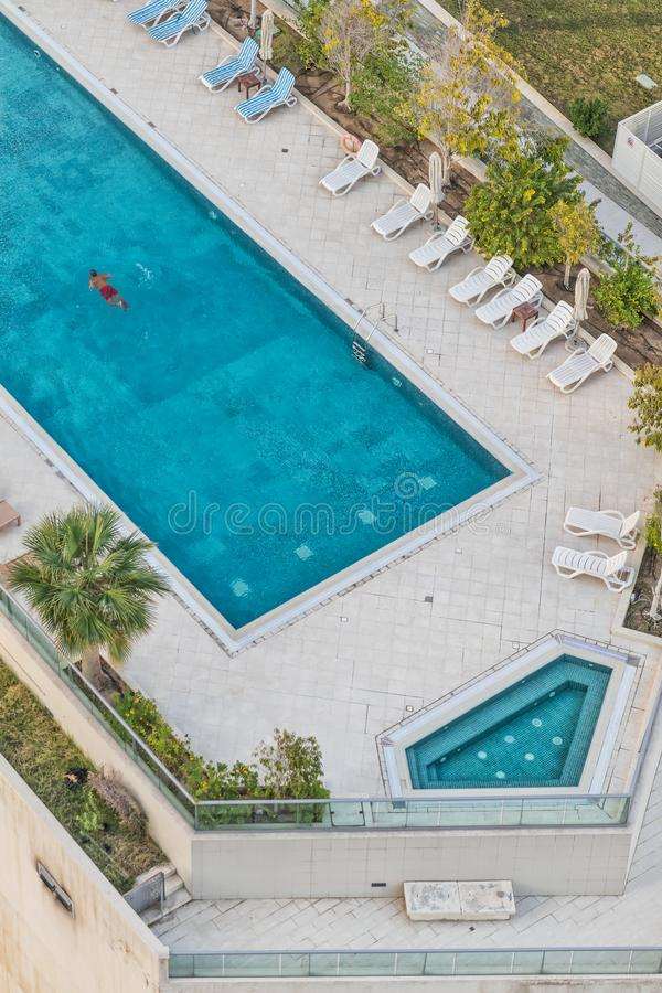 Aerial photograph of man swimming in pool with blue water royalty free stock photo