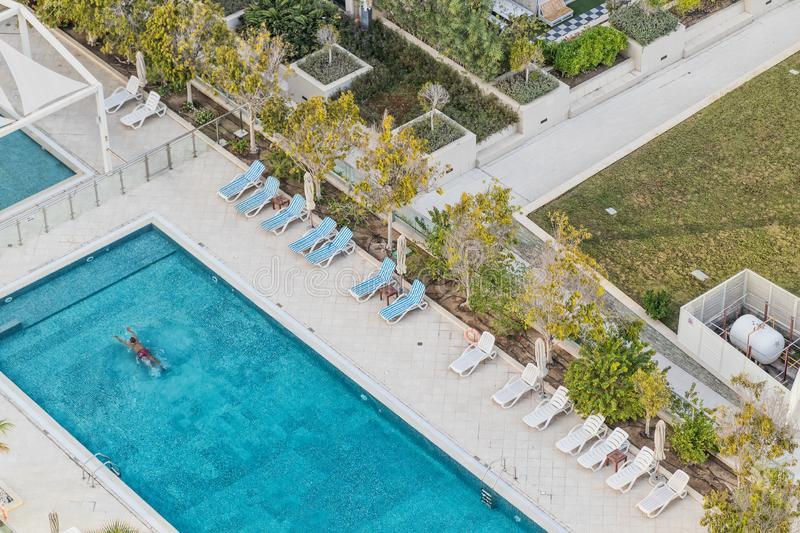 Aerial photograph of man swimming in pool with blue water. Dubai stock image