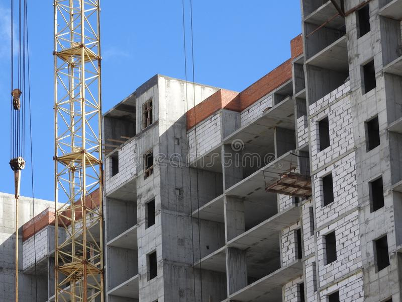 Construction site cranes, work on the construction of the house royalty free stock image