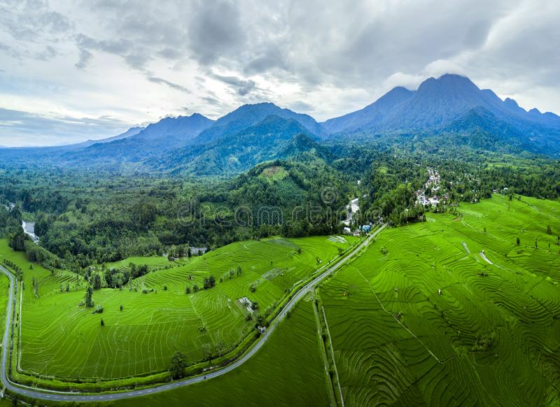 Aerial photographs of extraordinary mountains with fog and clouds, incredible sky, the sun that shines brightly above the rice fie. Lds very dramatically during royalty free stock photos