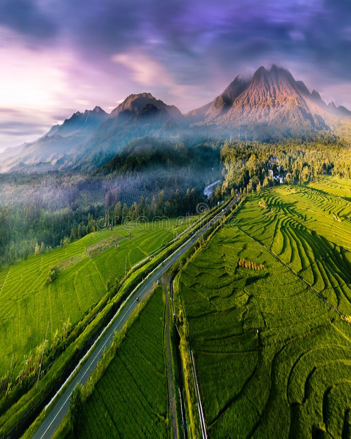 Aerial photographs of extraordinary mountains with fog and clouds, incredible sky, the sun that shines brightly above the rice fie stock image