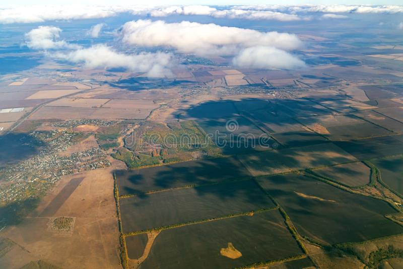 Aerial photography above cloud with big river among square green field of agriculture in countryside stock image
