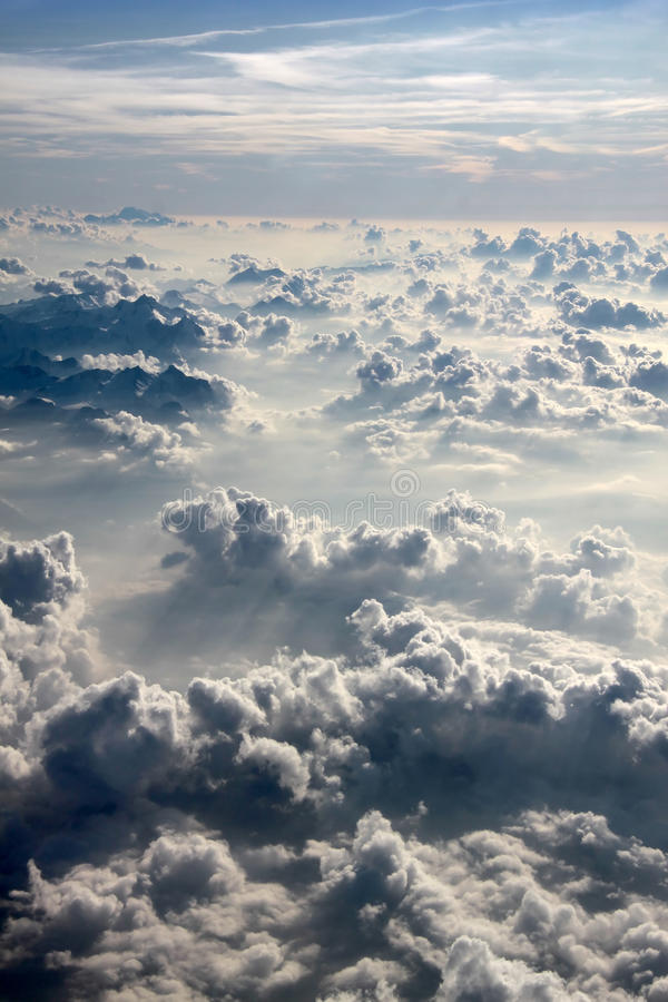 Aerial photography with clouds. Aerial photography over the Alps with clouds in the evening stock photography