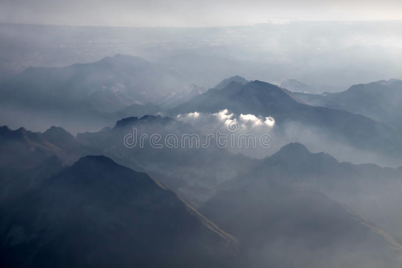 Aerial photography with clouds. Aerial photography over the southern Alps with clouds in the evening stock photos