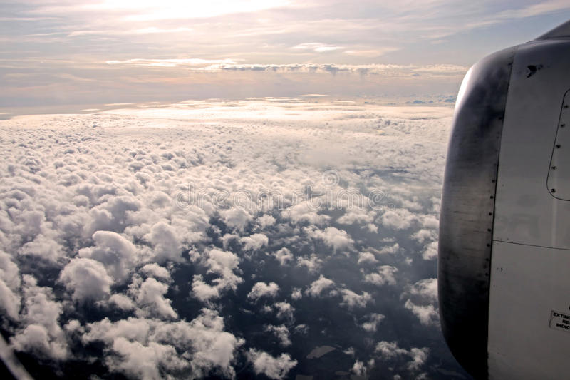 Aerial photography with clouds. Aerial photography of clouds and aircraft engine in the evening royalty free stock photos