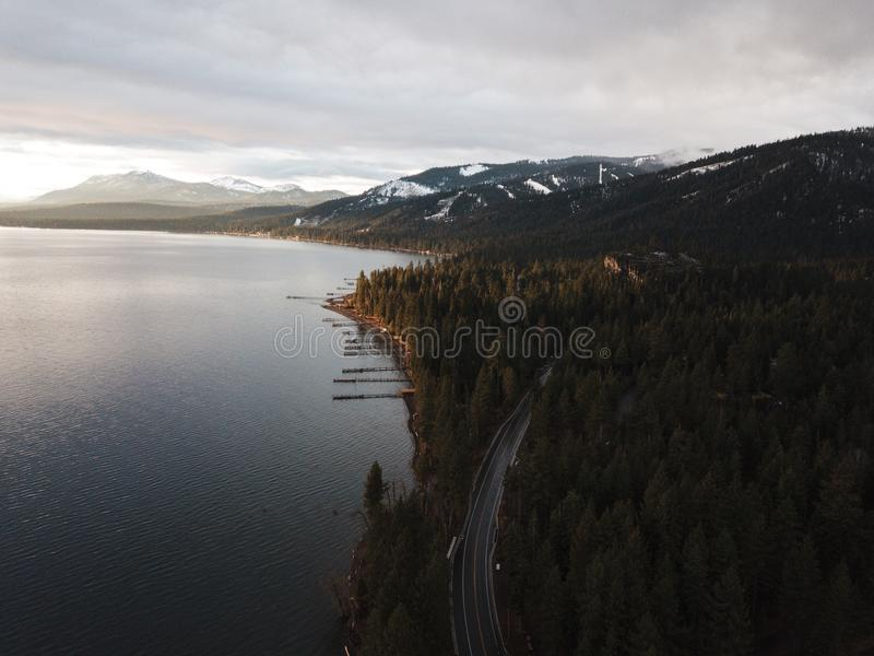 Aerial Photography of Dense Forest Near Body of Water royalty free stock photo