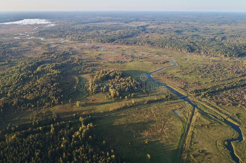 Aerial photography with a drone. Landscape with green forest, road and river royalty free stock images