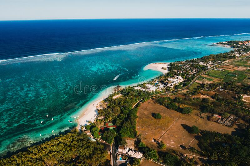 Aerial photography of the East coast of the island of Mauritius. Flying over the turquoise lagoon of Mauritius in the Belle Mare. Area.Coral reef of Mauritius royalty free stock images
