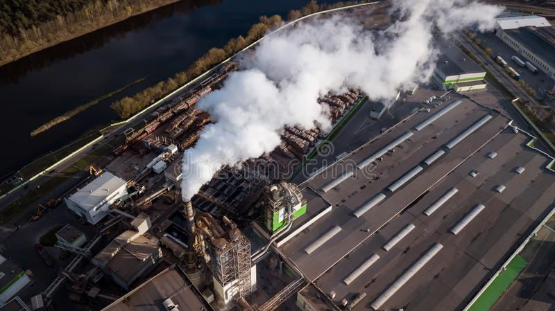 Aerial photography factory for processing wood. The smoke from the chimneys stock images