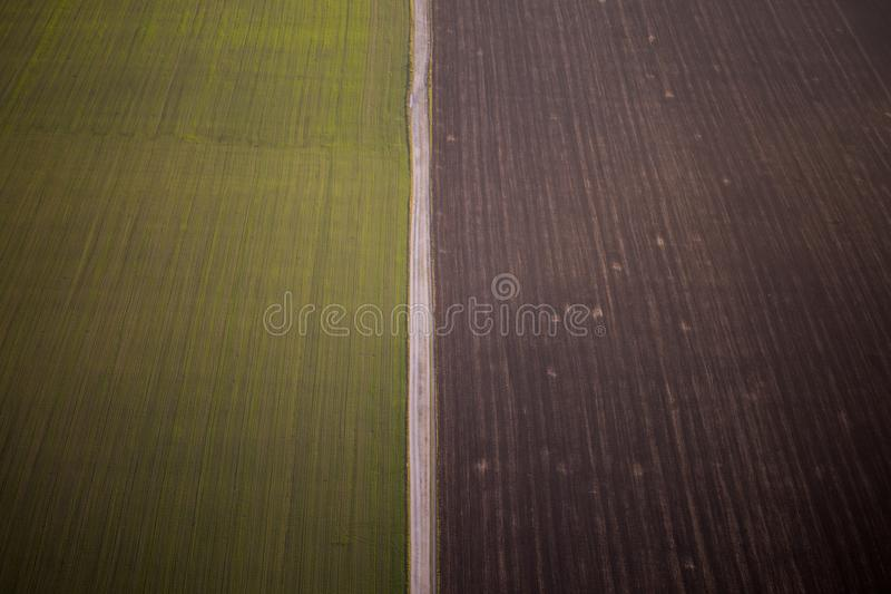 Aerial photography field where two parts of the field are separated by road stock photos