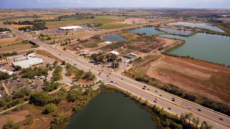 Aerial Photography of an Open Road With Cars Near City and Lake during Daytime royalty free stock photos