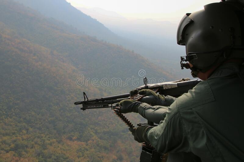 Aerial Photography Of Person Holding Machine Gun During Daytime Free Public Domain Cc0 Image