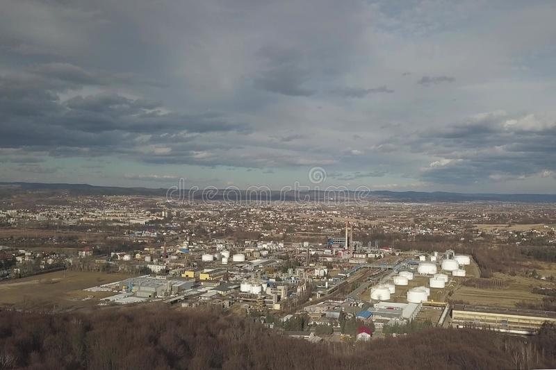 Aerial photography from a quadrocopter refinery in the sun again. St the backdrop of thunderclouds. Shooting at a height of bird flight using an airplane, a royalty free stock photography