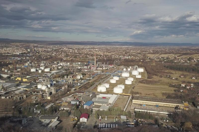 Aerial photography from a quadrocopter refinery in the sun again. St the backdrop of thunderclouds. Shooting at a height of bird flight using an airplane, a stock photography