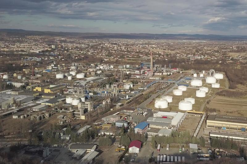 Aerial photography from a quadrocopter refinery in the sun again. St the backdrop of thunderclouds. Shooting at a height of bird flight using an airplane, a royalty free stock image