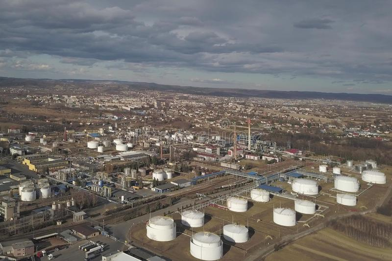 Aerial photography from a quadrocopter refinery in the sun again. St the backdrop of thunderclouds. Shooting at a height of bird flight using an airplane, a stock photos