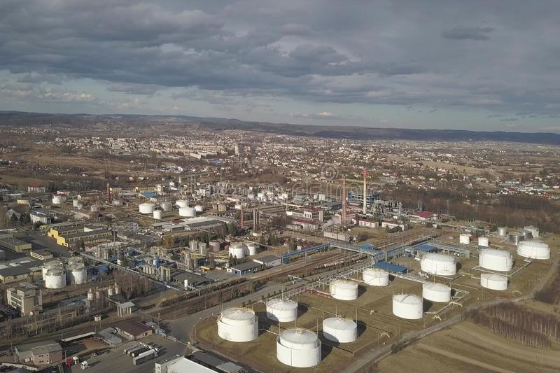 Aerial photography from a quadrocopter refinery in the sun again. St the backdrop of thunderclouds. Shooting at a height of bird flight using an airplane, a stock photo
