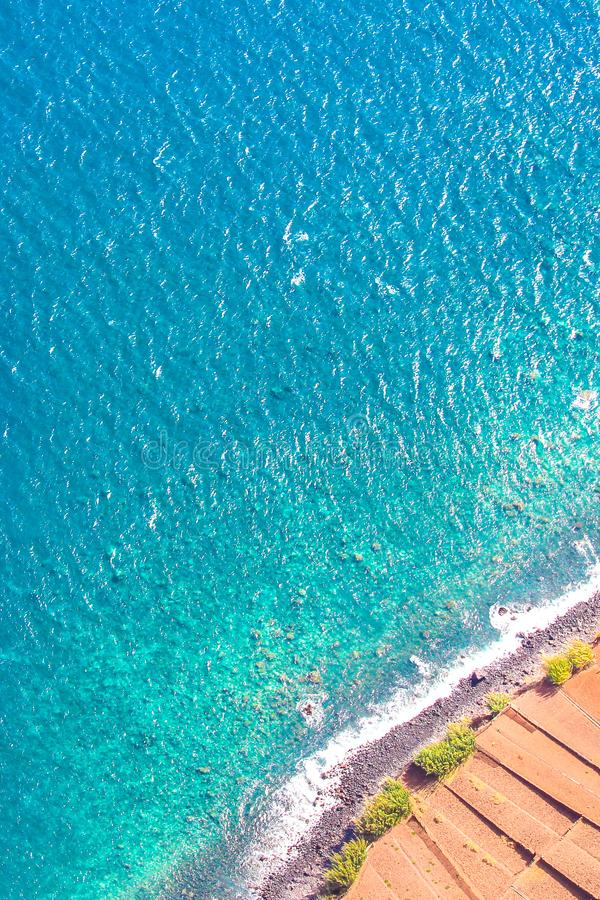 Aerial photography of the turquoise Atlantic ocean coast in Madeira, Portugal. Stone beach and adjacent fields on the southern royalty free stock images