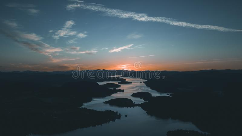 Aerial Photography of Water Beside Forest during Golden Hour royalty free stock photos
