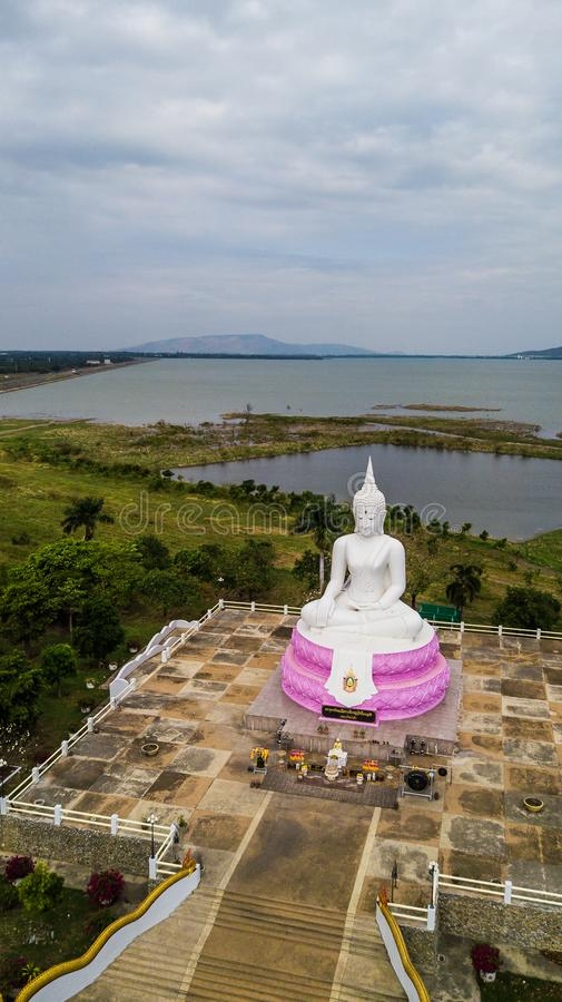 Aerial photos of White Buddha status in Thailand.  stock photography