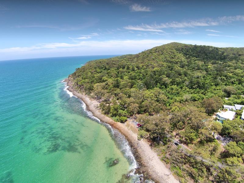 Aerial picture image of Noosa Heads. Aerial image of Noosa Heads National Park with clean surf breaks and clear blue tropical waters. No holiday makers on beach stock photography