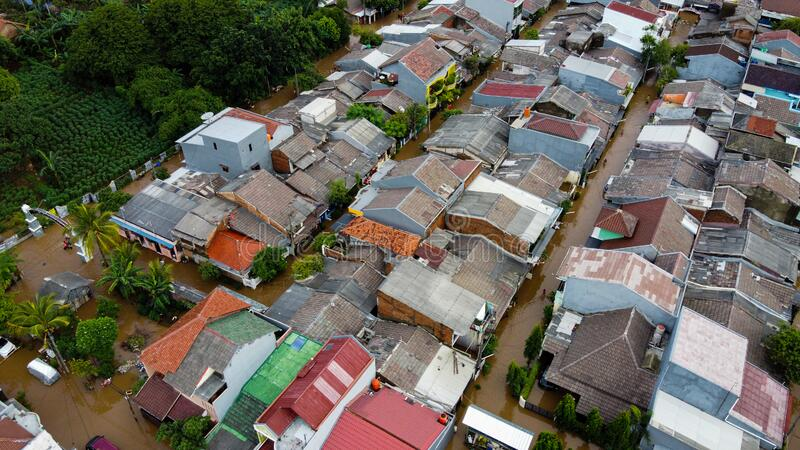 Aerial POV view Depiction of flooding. devastation wrought after massive natural disasters at Bekasi - Indonesia stock photography