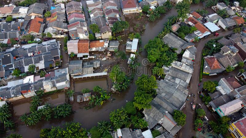 Aerial POV view Depiction of flooding. devastation wrought after massive natural disasters at Bekasi - Indonesia stock photos