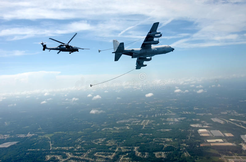 Aerial refueling of helicopter royalty free stock photos