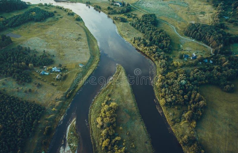 Aerial river landscape near Kernave. Aerial river landscape in forest stock photo