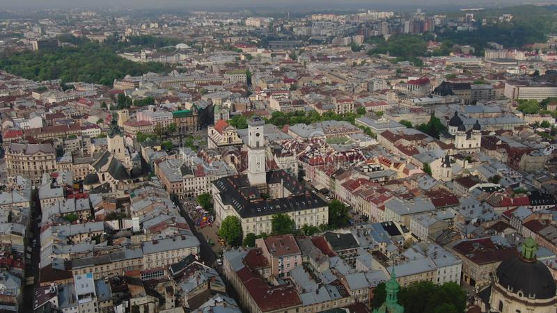 Aerial Roofs and streets Old City Lviv, Ukraine. Panorama of the ancient town. City Council, Town Hall, Ratush, old royalty free stock photos
