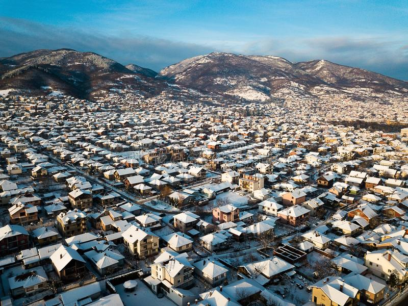 Aerial of rooftops covered with snow stock photo