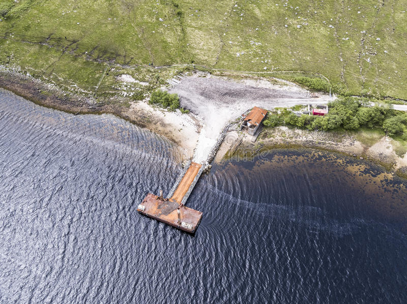 Aerial of the rotten old pier on the shores of Loch Etive. Aerial of the rotten old pier on the shore of Loch Etive, Scotland stock photos