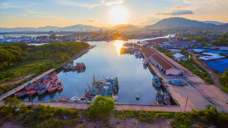 Aerial view reflection of sunset at three junction canal. Aerial scenery sunset at Siray fishing port. Phuket Fishing Port is the largest fishing port. Located stock image