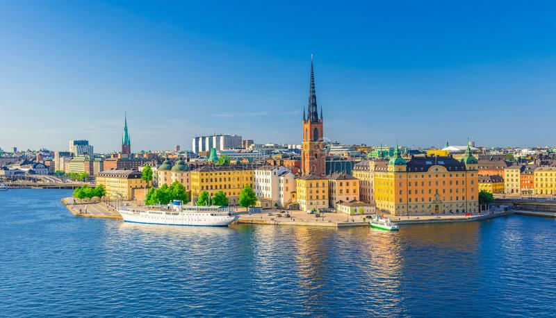 Aerial scenic panoramic view of Stockholm skyline with Old town Gamla Stan. Typical Sweden houses, Riddarholmen island with gothic Church building, Lake royalty free stock photo