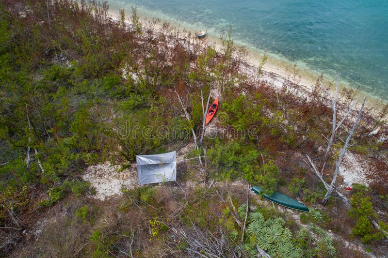 Secluded island camp site aerial drone image. Aerial search and rescue photo of a stranded came site on a secluded island royalty free stock image