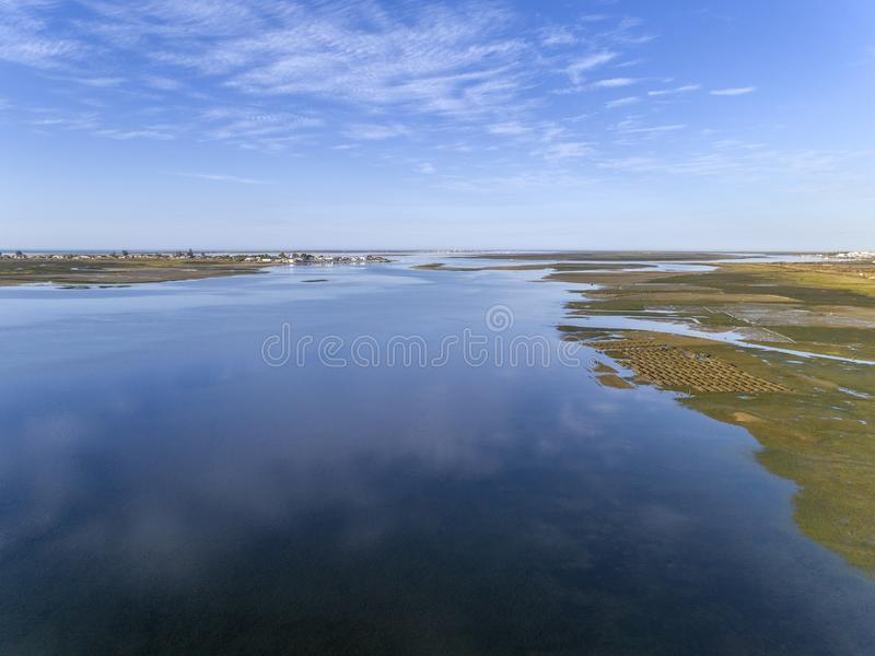 Aerial seascape, in Ria Formosa wetlands natural park, over Cavacos beach. Algarve. stock images