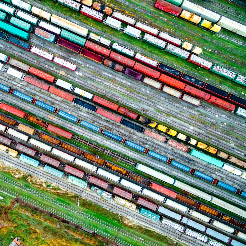 Aerial shoot of railway tracks with lots of wagons. Aerial shoot of railway tracks with lots of colorful train wagons stock photo